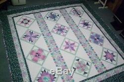 Beautiful Handmade quilt with green, pink, blue Queen Size